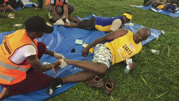 A City Medical Ambulance first aider attends to an injured participant
