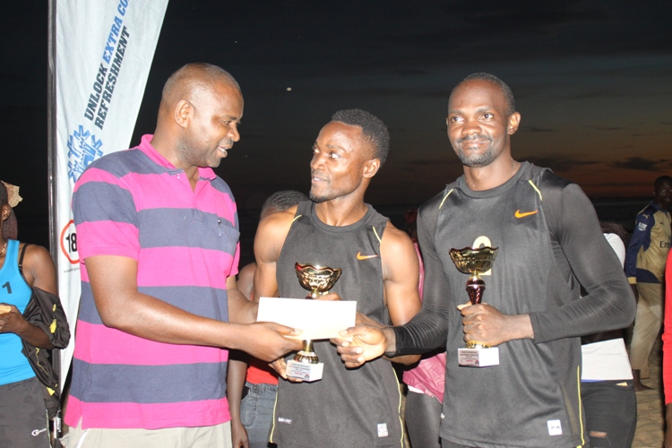 Out-going UVF President Sadiq Nasiwu hands over prizes at previous Beach Soccer tourney
