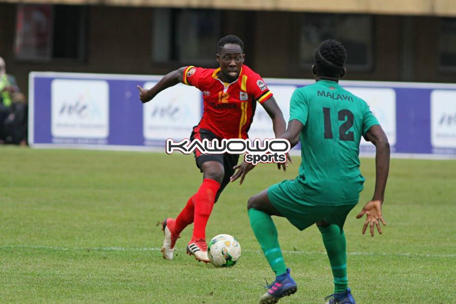 Kawowo Sports | JOHN BATANUDDE Denis Iguma in action against Malawi. The game ended goal-less after 90 minutes at Namboole Stadium