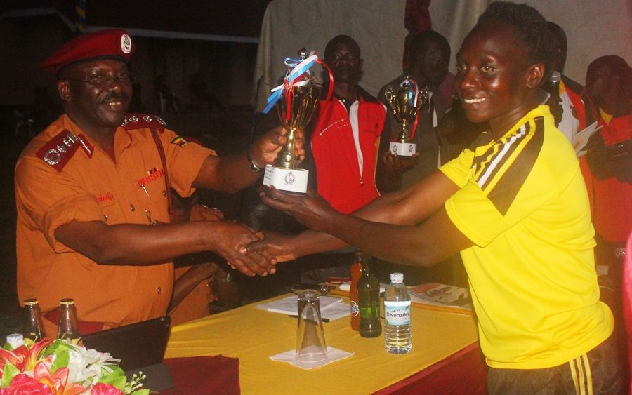 Commissioner General's Cup: Prison Academy and Training School clinch historic double #Uganda Commissioner hands over Netball Trophy 900x563