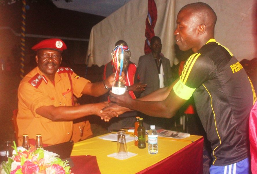 Commissioner General's Cup: Prison Academy and Training School clinch historic double #Uganda Commissioner hands over PATS football captain the trophy 886x600