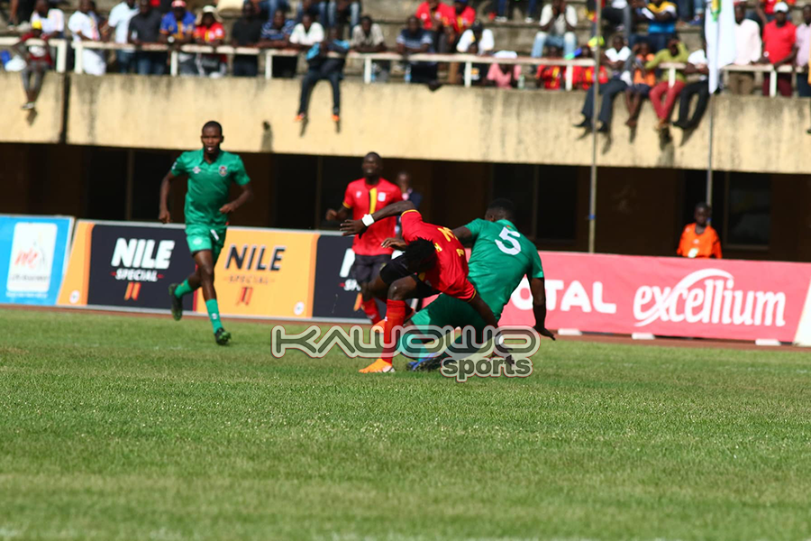 AFCON 2021 Qualifiers: Okwi, Bayo score to inspire Uganda Cranes over Malawi Flames #Uganda Fahad Bayo tumbles UGAMAL Kawowo 900x600